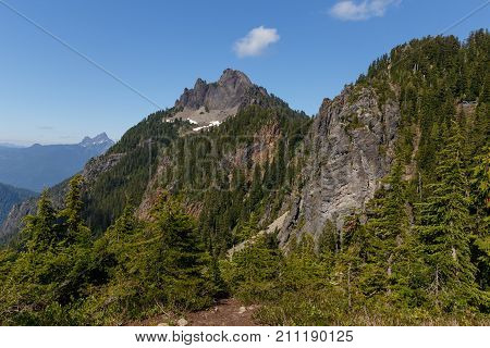Mount Forgotten Peak and area landscape with White Chuck Mountain in the background as seen during the summer hiking season.