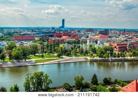 Wroclaw/Poland- August 18, 2017: aerial panoramic cityscape - river Odra, historical and modern buildings, alley, park and green trees summertime, blue sky