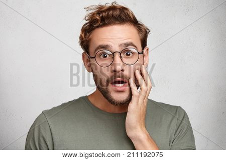 It`s Unbelievable! Surprised Stunned Emotional Man Keeps Hand On Cheek, Being Shocked To See High Sa
