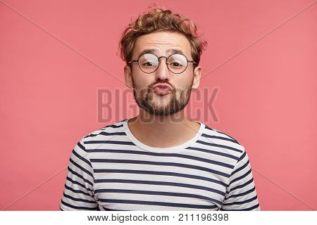 Funny Male With Curly Trendy Hairstyle, Rounds Lips As Going To Kiss Someone, Looks In Anticipation,