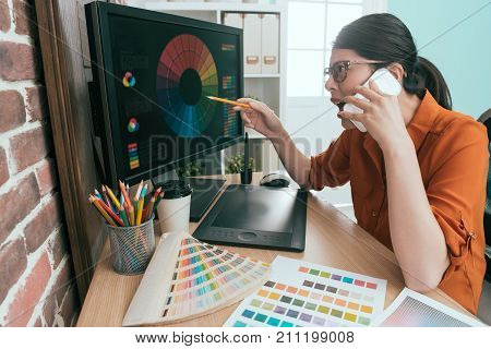 Female Manager Working On Graphic Design Company
