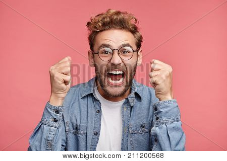 Angry Furious Businessman Screams Loudly, Raises Fists, Doesn`t Control His Negative Emotions, Faile