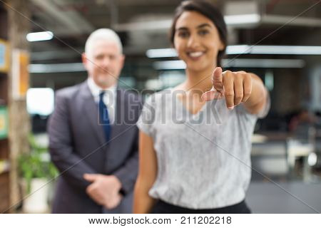Cheerful businesswoman pointing with index finger to camera calling to belong to their team. Business specialist choosing you. Agitation concept poster