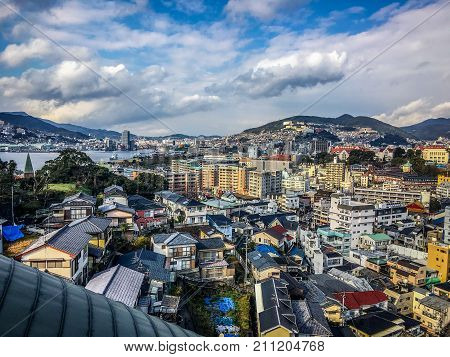 Aerial city landscape view of modern Nagasaki on Kyushu island Japan