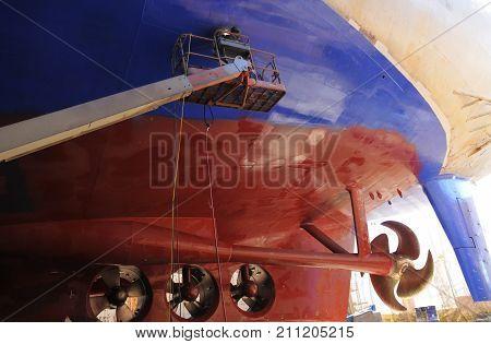 Big Ship Under Repairing On Floating Dry Dock In Shipyard