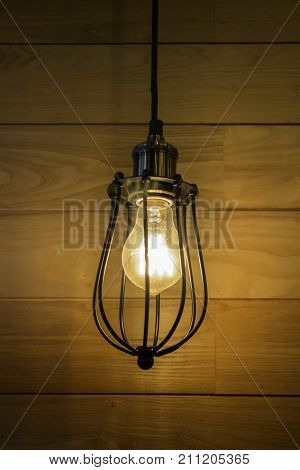 Vintage bulb on wooden wall stock photo