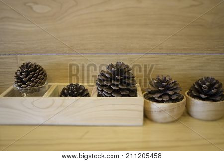 Brown pine cones on wooden table stock photo