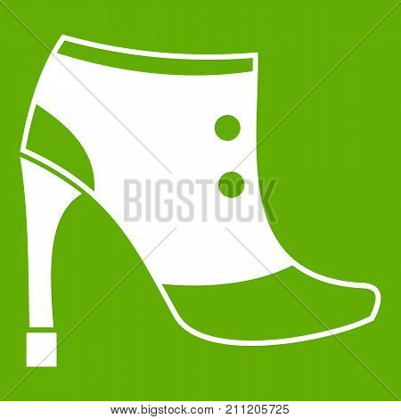 Women boots icon white isolated on green background. Vector illustration