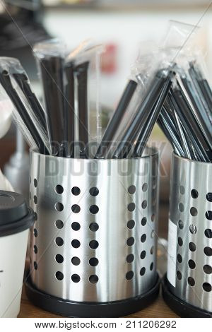 Black drinking straws in box ready to use in coffee shop