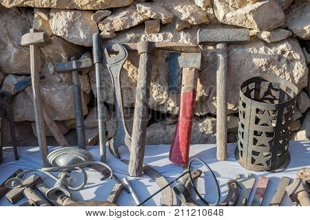 MAMSHIT ISRAEL - OCTOBER 9 2017: Old rusty tools for sale at bedouin flea market