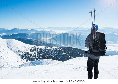 Alone sporting man in mountain, Young man walks mountains, Man sporting European winter mountains, Tourist athlete snowy mountains, Man mountain top, Young tourist in winter mountains
