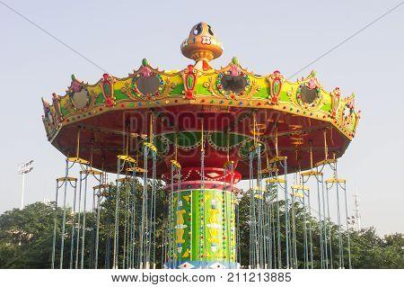 Carousel in amusement park background, beautifu architecture,
