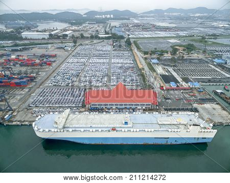 Aerial view car carrier ship in warehouse harbor at thailand .