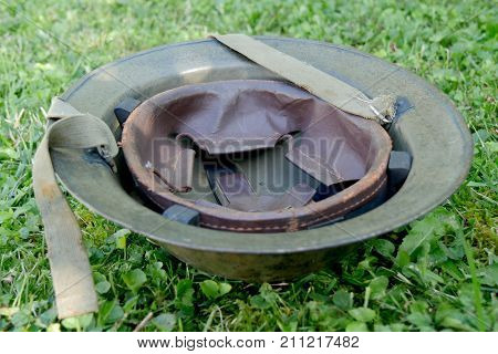 the wwii british helment on the grass