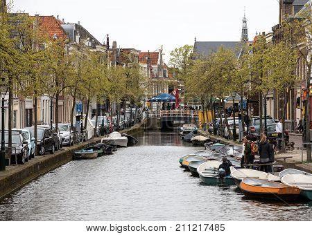 ALKMAAR NETHERLANDS - APRIL 21 2017: Historic old town of Alkmaar North Holland Netherlands typical canal houses