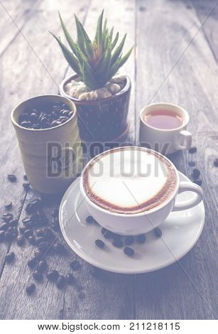 Cup Of Hot Coffee Cappuccino In Coffee Shop. Hot Cappuccino On Wooden Table With Vintage Filter
