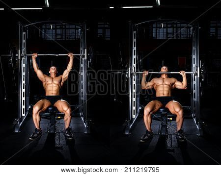Bodybuilding exercises tutorial concept. Muscular man doing exercise for shoulders with barbell on smith machine in gym. Power fitness man show how to train shoulders with lifting weights master class