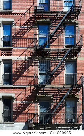 Fire escape ladder on bulding façade New York USA