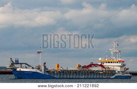 Dredger Contender Sailing In Copenhagen North Port