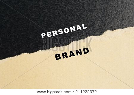 Personal brand words on torn paper black and brown colors.