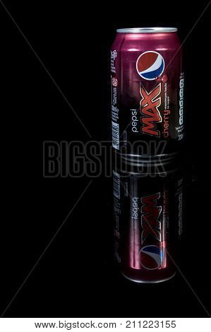 London 24th October 2017:- A can of Cherry Pepsi Max isolated on a black background