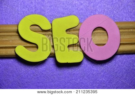 word seo pn an abstract colored background