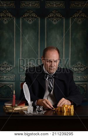 portrait of victorian business man stack his money