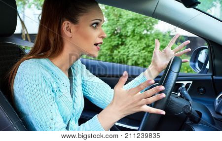 Annoyed Woman Driving A Car