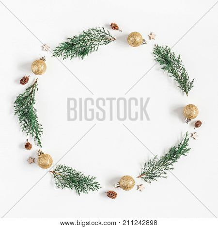 Christmas composition. Christmas wreath made of pine branches balls pine conces on white background. Flat lay top view copy space square