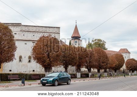 Prejmer Romania October 06 2017 : Protective walls and watchtower with the clock of the Fortified Church Prejmer in Prejmer city in Romania