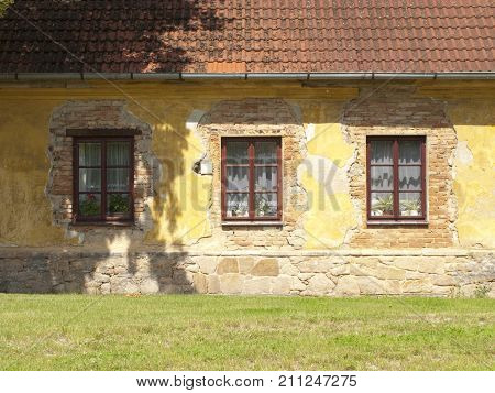 Frontside of old deteriorating house on a sunny day