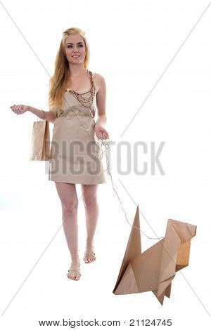 Girl walking eco dog holding paper recycle bag