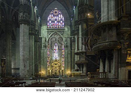MILAN, ITALY - MAY 11 2014: Duomo Catheral in Milan interiors of the liturgic area with benches and the altar no people