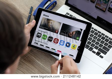 Alushta Russia - June 7 2017: Man hand holding iPad and MacBook with App Store on the screen. iPad and MacBook was created and developed by the Apple inc.