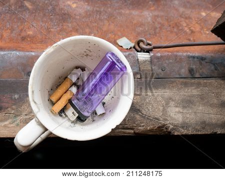 Cigarette Discard And Break To Coffee Cup With  Lighter To Quitting Smoking And Caffeine.
