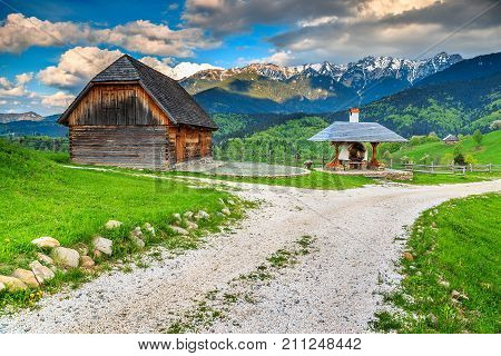 Stunning rural farm with old wooden hut and oven, Bran, Transylvania, Romania, Europe