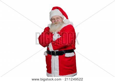 Santa Claus crossed arms on white background. Kind bearded Santa Claus with ams folded over white background. Studio shot of realistic Santa Claus.