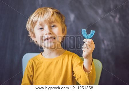 Three-year Old Boy Shows Myofunctional Trainer. Helps Equalize The Growing Teeth And Correct Bite, D