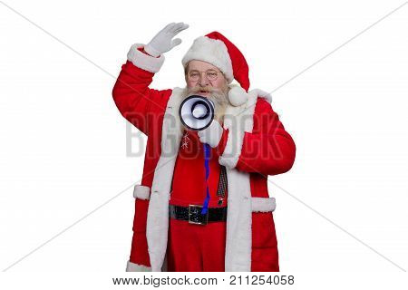 Santa Claus speaking using megaphone. Portrait of Santa Claus in eye glasses talking with megaphone isolated on white background.