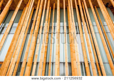 Wooden fasade with columns of the modern building for background
