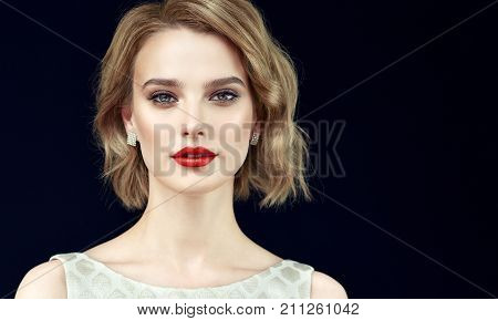 Beautiful model girl with short curly  hair and red lips . Beauty and esthetic care poster