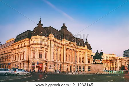 Bucharest, Romania - September 8, 2017: Central University Library and Carol I statue on horse on Calea Victoriei at sunset, Bucharest, Romania