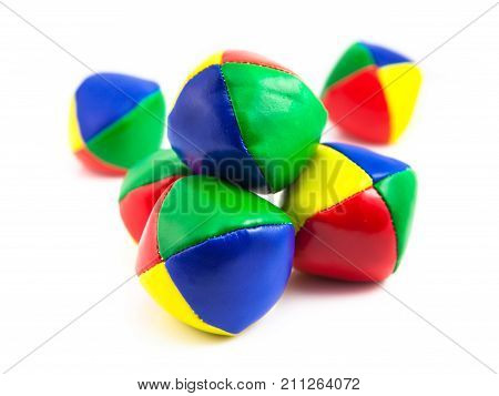 Concept for Business Challenges Stack of Colorful Juggling Balls on White Background poster