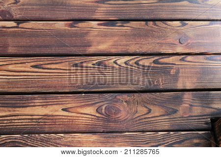 Structure of the scorched wood. Wooden boards are adored with fire.