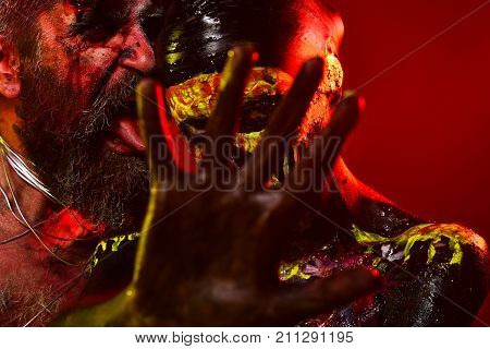 Halloween Couple With Stop Hand Gesture On Red Background
