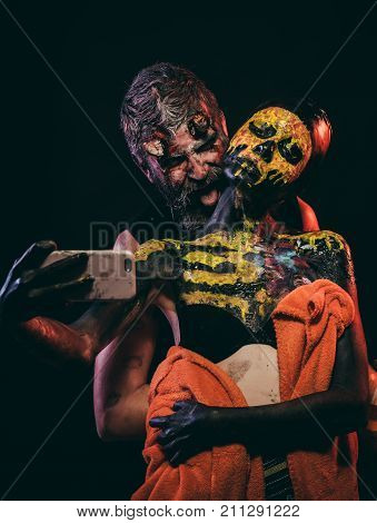 Halloween Couple Make Selfie With Mobile Phone On Black Background