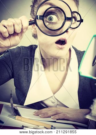 Businesswoman Explore Documents With Big Loupe.