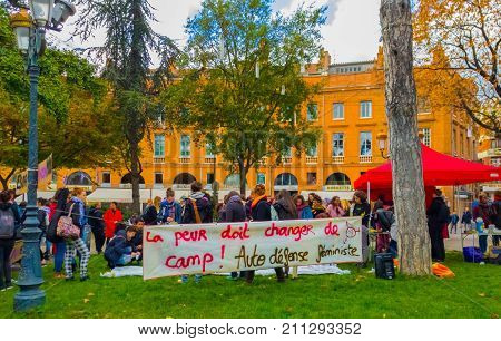 TOULOUSE FRANCE - OCTOBER 292017: The demonstrators in the street to denounce sexual harassment.Inscription:Fear must change the camp. Self-defense woman.