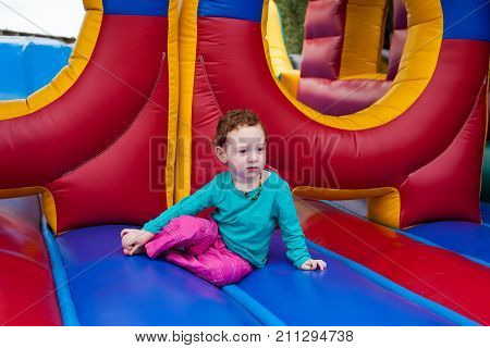 Toddler Kid Stopped In The Game Of Bounce