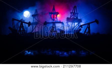 Oil Pump Oil Rig Energy Industrial Machine For Petroleum, Group Oil Rigs And Brightly Lit Industrial
